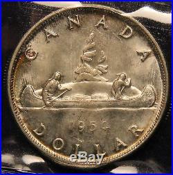 1954 Canada Silver Dollar ICCS MS-65 Gem Uncirculated. Colorful rim toning WK191